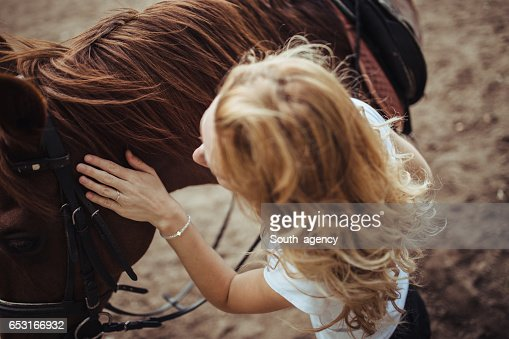 She loves horses : Stock-Foto