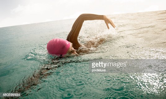 She pushes her limits with every swim : Stock Photo