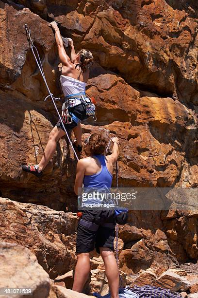 She trusts her belaying partner wholeheartedly