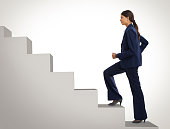 Studio shot of a motivated businesswoman climbing a flight of stairshttp://195.154.178.81/DATA/i_collage/pi/shoots/785299.jpg