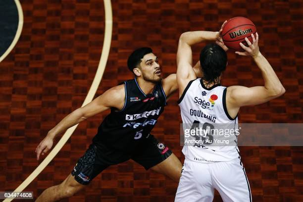 Shea Ili of the Breakers reaches in against Chris Goulding of United during the round 19 NBL match between the New Zealand Breakers and Melbourne...