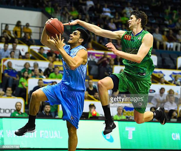 Shea Lli of the Breakers attempts a layup past Clint Steindl of the Crocodiles during the round nine NBL match between the Townsville Crocodiles and...