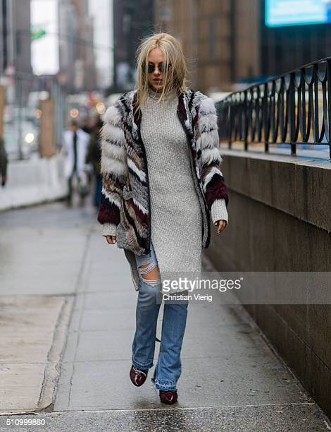 Shea Marie wearing a fur and a long sweater and ripped jeans seen outside Vera Wang during New York Fashion Week Women's Fall/Winter 2016 on February...