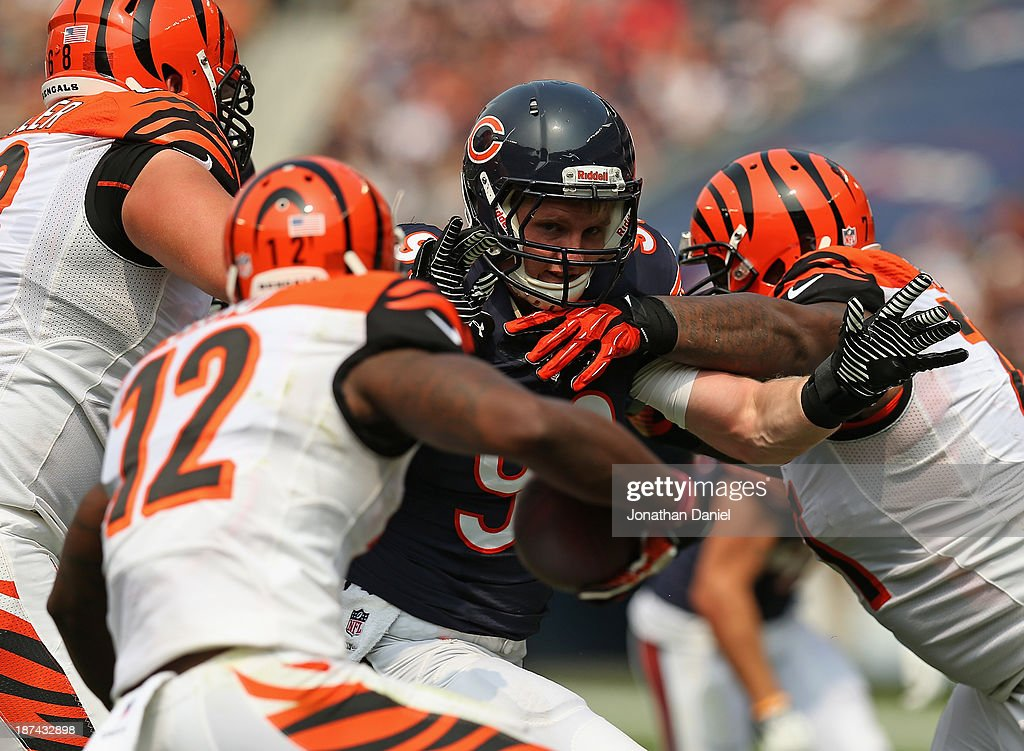 <a gi-track='captionPersonalityLinkClicked' href=/galleries/search?phrase=Shea+McClellin&family=editorial&specificpeople=5547393 ng-click='$event.stopPropagation()'>Shea McClellin</a> #99 of the Chicago Bears rushes against Andre Smith #71 and <a gi-track='captionPersonalityLinkClicked' href=/galleries/search?phrase=Kevin+Zeitler&family=editorial&specificpeople=6243545 ng-click='$event.stopPropagation()'>Kevin Zeitler</a> #68 of the Cincinnati Bengals at Soldier Field on September 8, 2013 in Chicago, Illinois. The Bears defeated the Bengals 24-21.