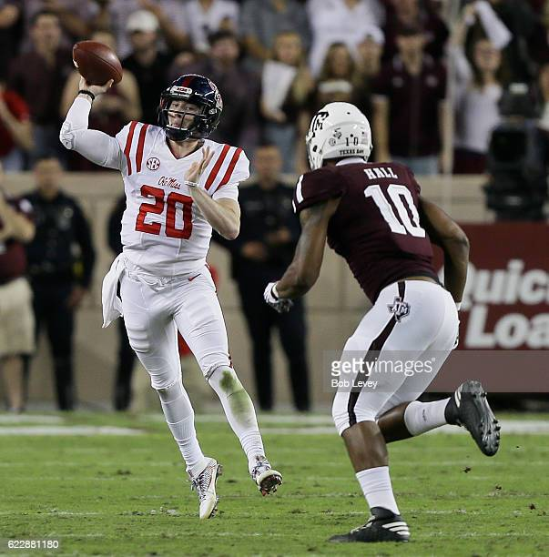 Shea Patterson of the Mississippi Rebels throws pass as he is pressured by Daeshon Hall of the Texas AM Aggies at Kyle Field on November 12 2016 in...