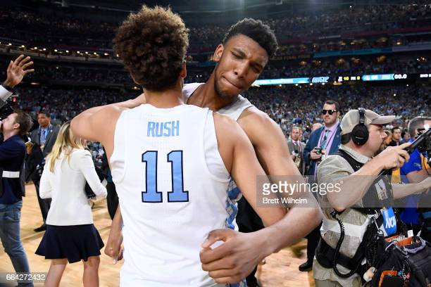 Shea Rush and Tony Bradley of the North Carolina Tar Heels embrace after time expires during the 2017 NCAA Men's Final Four National Championship...