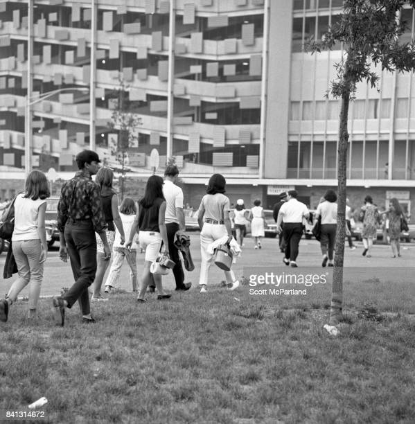 Fans make their way towards the entrances of Shea Stadium to see The Beatles live on their last American Tour