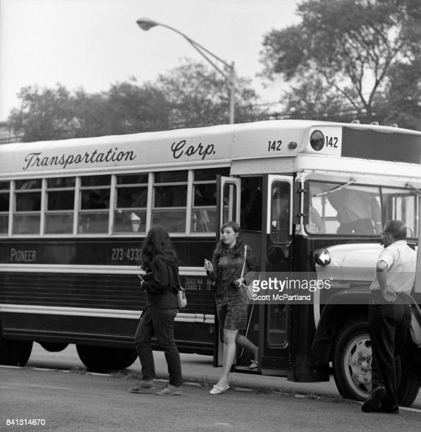 Teenage Beatles fans exit a chartered bus in the parking lot of Shea Stadium on their way to see the band live on their last American Tour
