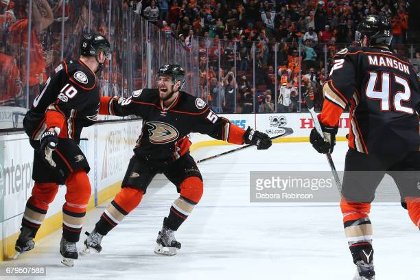Shea Theodore Corey Perry and Josh Manson of the Anaheim Ducks celebrate Perry's gamewinning goal in the second overtime period against the Edmonton...
