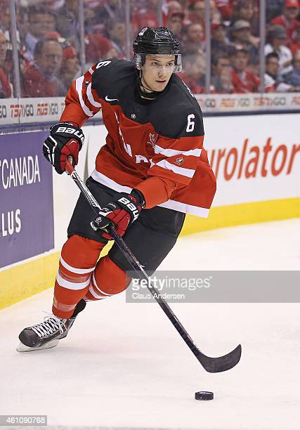 Shea Theodore of Team Canada skates with the puck against Team Russia during the gold medal game in the 2015 IIHF World Junior Hockey Championship at...