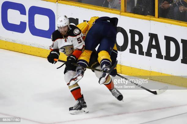 Shea Theodore of the Anaheim Ducks checks Austin Watson of the Nashville Predators during the third period in Game Three of the Western Conference...