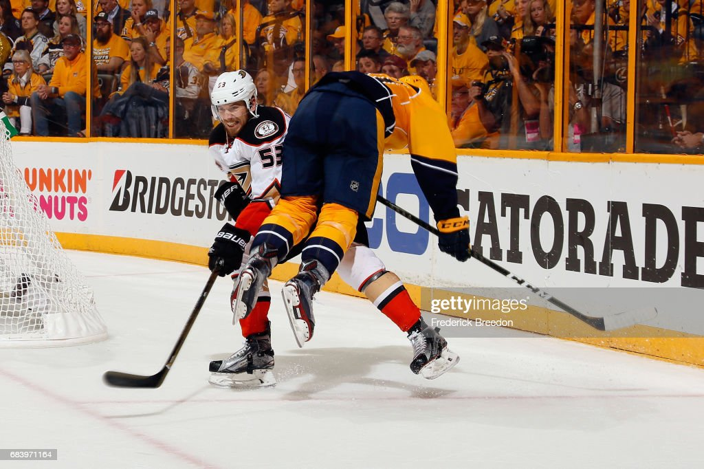Shea Theodore #53 of the Anaheim Ducks checks Austin Watson #51 of the Nashville Predators during the third period in Game Three of the Western Conference Final during the 2017 Stanley Cup Playoffs at Bridgestone Arena on May 16, 2017 in Nashville, Tennessee.