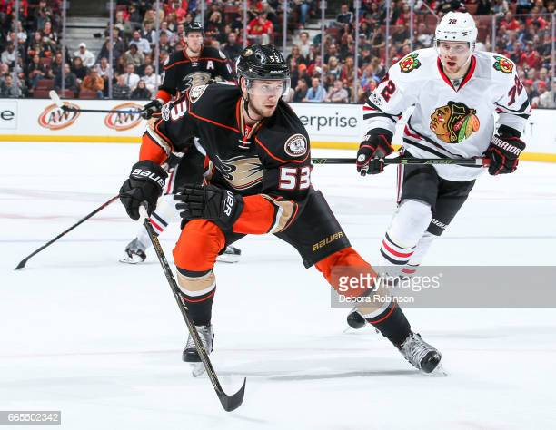 Shea Theodore of the Anaheim Ducks skates pursued by Artemi Panarin of the Chicago Blackhawks during the second period of the game at Honda Center on...