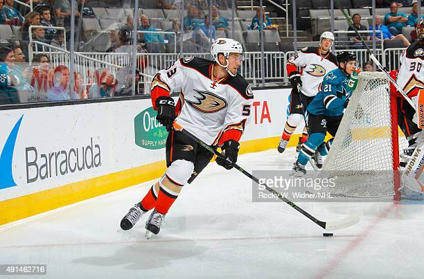 Shea Theodore of the Anaheim Ducks skates with the puck against the San Jose Sharks at SAP Center on September 26 2015 in San Jose California