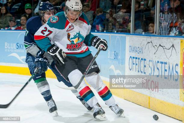Shea Theodore of the Seattle Thunderbirds checks Ryan Olsen of the Kelowna Rockets behind the net during the first period on February 10 2014 at...