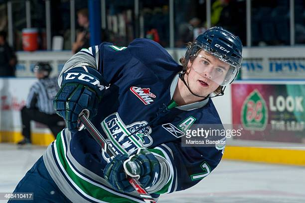 Shea Theodore of the Seattle Thunderbirds takes a shot on net during warm up against the Kelowna Rockets on February 10 2014 at Prospera Place in...