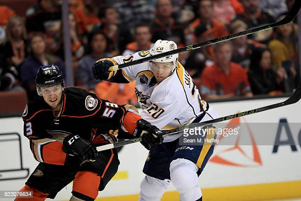 Shea Theodore of the the Anaheim Ducks and Miikka Salomaki of the the Nashville Predators battle for position during the second period of Game Two of...