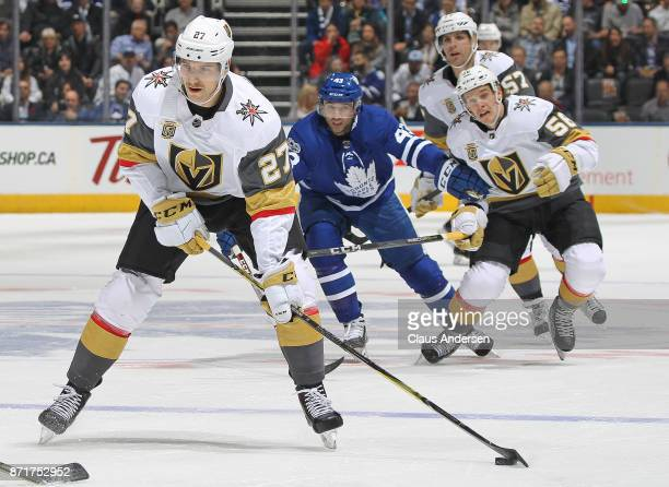 Shea Theodore of the Vegas Golden Knights gets set to fire a shot against the Toronto Maple Leafs during an NHL game at the Air Canada Centre on...