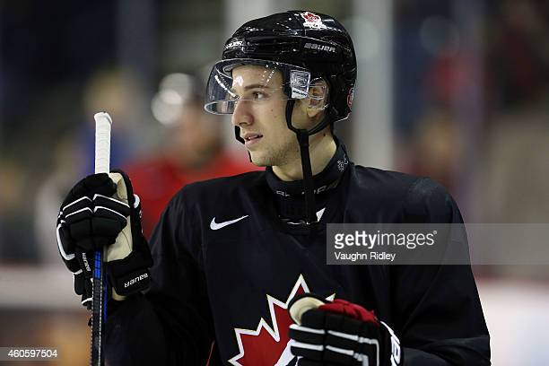 Shea Theodore places a spare stick in the bench during the Canada National Junior Team practice at the Meridian Centre on December 17 2014 in St...