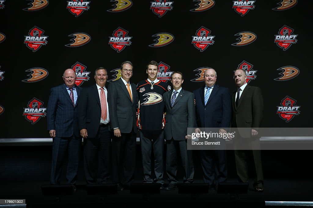 Shea Theodore poses for a photo with Anaheim Ducks team personnel, (from left) Bob Murray, Michael Schulman, Henry Samueli, Martin Madden, Bruce Boudreau and Jeff Crisp during the 2013 NHL Draft at the Prudential Center on June 30, 2013 in Newark, New Jersey.