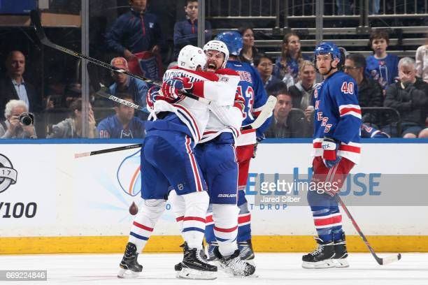 Shea Weber and Alex Galchenyuk of the Montreal Canadiens celebrate after scoring a goal in the third period against the New York Rangers in Game...