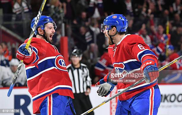 Shea Weber and Alexander Radulov of the Montreal Canadiens celebrate after scoring a goal the Toronto Maple Leafs in the NHL game at the Bell Centre...