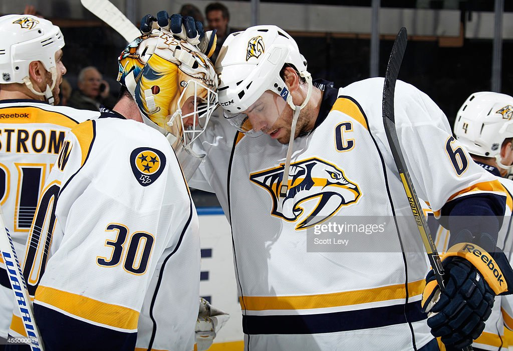 <a gi-track='captionPersonalityLinkClicked' href=/galleries/search?phrase=Shea+Weber&family=editorial&specificpeople=554412 ng-click='$event.stopPropagation()'>Shea Weber</a> #6 and <a gi-track='captionPersonalityLinkClicked' href=/galleries/search?phrase=Carter+Hutton&family=editorial&specificpeople=6872781 ng-click='$event.stopPropagation()'>Carter Hutton</a> #30 of the Nashville Predators celebrate following a 4-1 win over the New York Rangers at Madison Square Garden on December 10, 2013 in New York City.