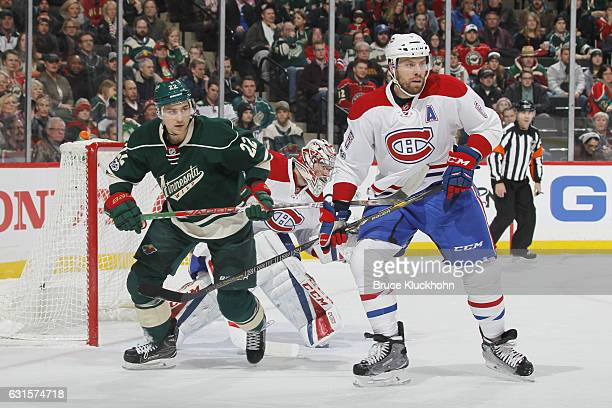 Shea Weber and goalie Carey Price of the Montreal Canadiens defend against Nino Niederreiter of the Minnesota Wild during the game on January 12 2017...