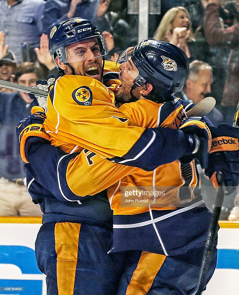 <a gi-track='captionPersonalityLinkClicked' href=/galleries/search?phrase=Shea+Weber&family=editorial&specificpeople=554412 ng-click='$event.stopPropagation()'>Shea Weber</a> #6 and <a gi-track='captionPersonalityLinkClicked' href=/galleries/search?phrase=Mike+Fisher+-+Ice+Hockey+Player&family=editorial&specificpeople=204732 ng-click='$event.stopPropagation()'>Mike Fisher</a> #12 of the Nashville Predators celebrate a goal against the Montreal Canadiens at Bridgestone Arena on December 21, 2013 in Nashville, Tennessee.