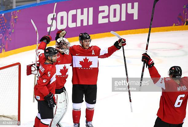 Shea Weber Carey Price Dan Hamhuis and Jonathan Toews of Canada celebrate after defeating Sweden 30 during the Men's Ice Hockey Gold Medal match on...