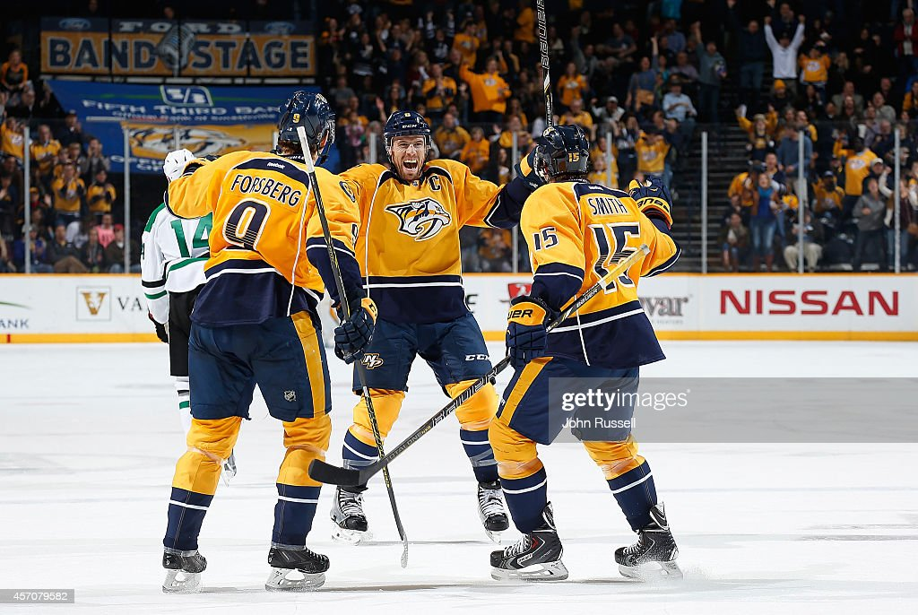 <a gi-track='captionPersonalityLinkClicked' href=/galleries/search?phrase=Shea+Weber&family=editorial&specificpeople=554412 ng-click='$event.stopPropagation()'>Shea Weber</a> #6 celebrates his goal with Craig Smith #15 and <a gi-track='captionPersonalityLinkClicked' href=/galleries/search?phrase=Filip+Forsberg&family=editorial&specificpeople=8768623 ng-click='$event.stopPropagation()'>Filip Forsberg</a> #9 of the Nashville Predators against the Dallas Stars at Bridgestone Arena on October 11, 2014 in Nashville, Tennessee.