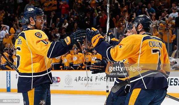 Shea Weber celebrates his goal with Matt Cullen of the Nashville Predators against the Buffalo Sabres during an NHL at Bridgestone Arena on March 27...