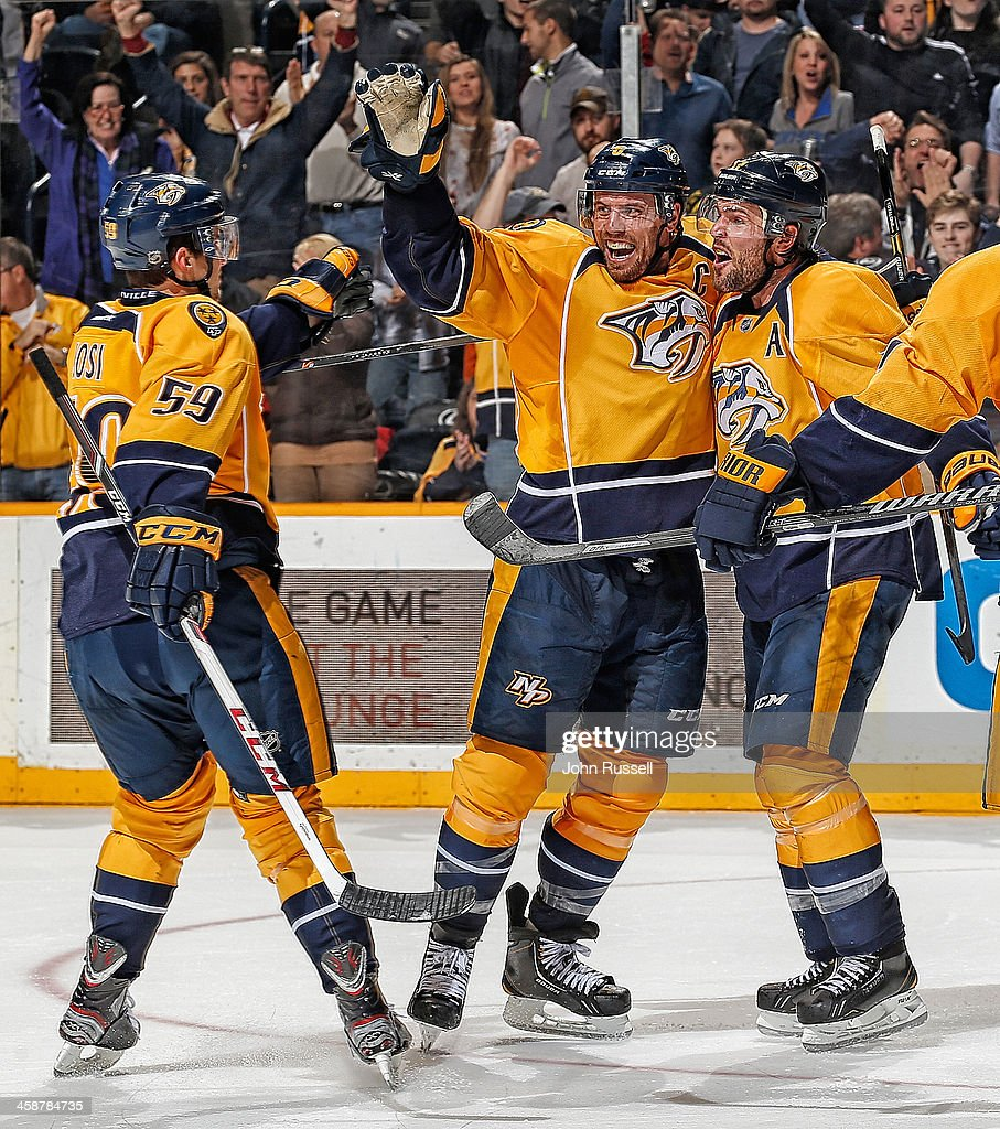 <a gi-track='captionPersonalityLinkClicked' href=/galleries/search?phrase=Shea+Weber&family=editorial&specificpeople=554412 ng-click='$event.stopPropagation()'>Shea Weber</a> #6 celebrates his goal with <a gi-track='captionPersonalityLinkClicked' href=/galleries/search?phrase=Roman+Josi&family=editorial&specificpeople=4247871 ng-click='$event.stopPropagation()'>Roman Josi</a> #59 and <a gi-track='captionPersonalityLinkClicked' href=/galleries/search?phrase=Mike+Fisher+-+Ice+Hockey+Player&family=editorial&specificpeople=204732 ng-click='$event.stopPropagation()'>Mike Fisher</a> #12 of the Nashville Predators against the Montreal Canadiens at Bridgestone Arena on December 21, 2013 in Nashville, Tennessee.