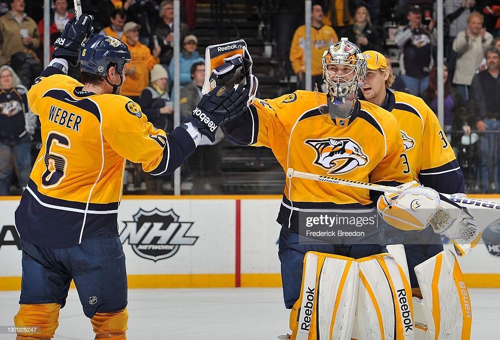 Shea Weber #6 congratulates goalie Pekka Rinne #35 of the Nashville Predators for a victory over the Philadelphia Flyers at Bridgestone Arena on January 14, 2012 in Nashville, Tennessee.