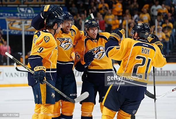 Shea Weber Craig Smith Filip Forsberg and Derek Roy of the Nashville Predators celebrate a goal against the Dallas Stars at Bridgestone Arena on...