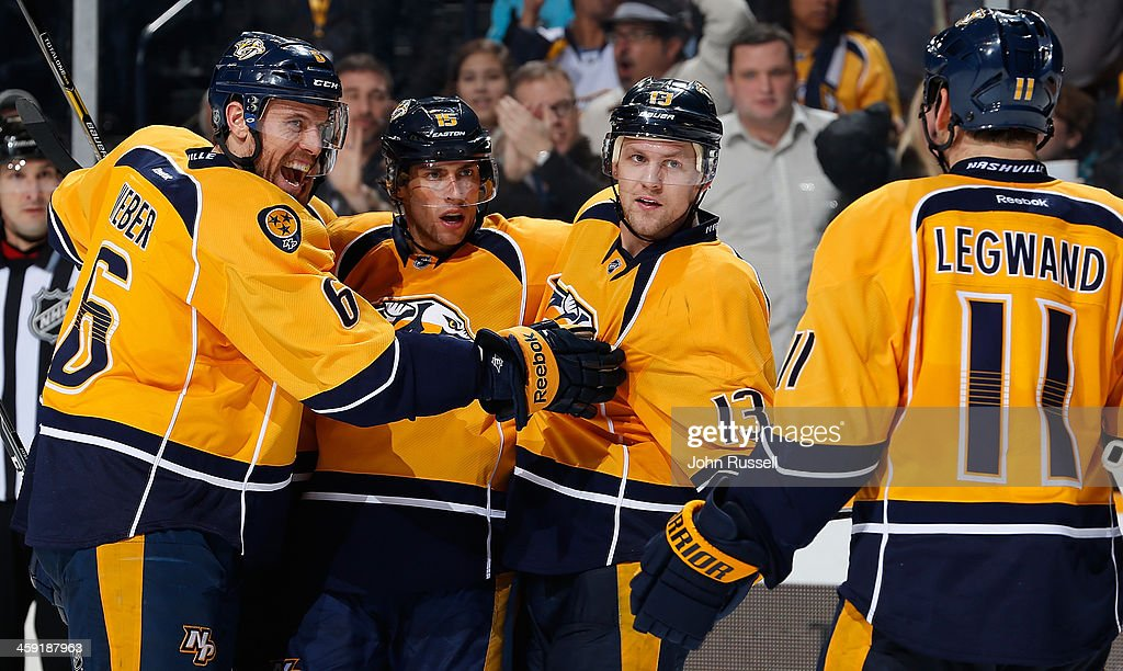 Shea Weber #6, Craig Smith #15, Nick Spaling #13 and David Legwand #11 of the Nashville Predators celebrate a goal against the Boston Bruins at Bridgestone Arena on December 23, 2013 in Nashville, Tennessee.
