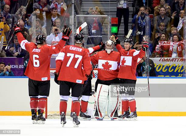 Shea Weber Jeff Carter Carey Price and Jonathan Toews of Canada celebrate after defeating Sweden 30 during the Men's Ice Hockey Gold Medal match on...