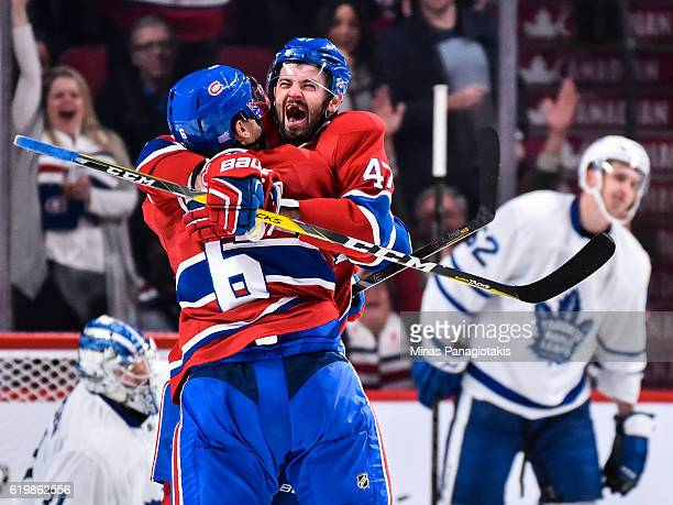 Shea Weber of the Montreal Canadiens celebrates his goal with teammate Alexander Radulov during the NHL game against the Toronto Maple Leafs at the...