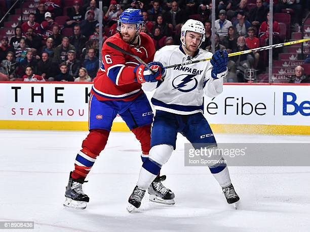 Shea Weber of the Montreal Canadiens defends against Jonathan Drouin of the Tampa Bay Lightning during the NHL game at the Bell Centre on October 27...