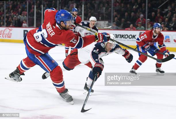 Shea Weber of the Montreal Canadiens fires a slap shot against Jack Johnson of the Columbus Blue Jackets in the NHL game at the Bell Centre on...