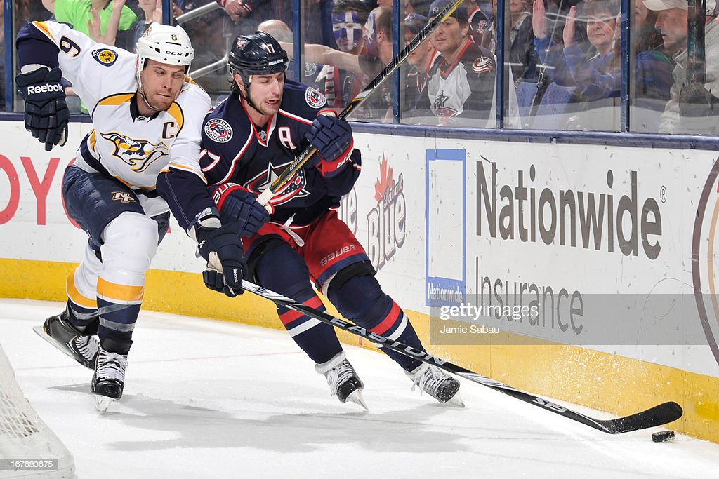 <a gi-track='captionPersonalityLinkClicked' href=/galleries/search?phrase=Shea+Weber&family=editorial&specificpeople=554412 ng-click='$event.stopPropagation()'>Shea Weber</a> #6 of the Nashville Predators and <a gi-track='captionPersonalityLinkClicked' href=/galleries/search?phrase=Brandon+Dubinsky&family=editorial&specificpeople=2271907 ng-click='$event.stopPropagation()'>Brandon Dubinsky</a> #17 of the Columbus Blue Jackets battle for possession of the puck during the third period on April 27, 2013 at Nationwide Arena in Columbus, Ohio. Columbus defeated Nashville 3-1.