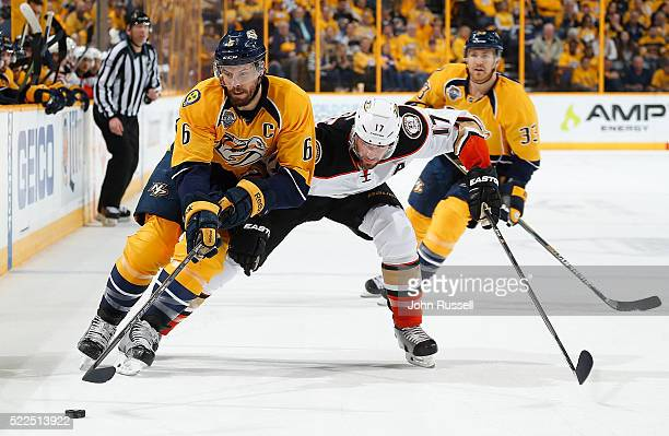 Shea Weber of the Nashville Predators battles for the puck against Ryan Kesler of the Anaheim Ducks in Game Three of the Western Conference First...