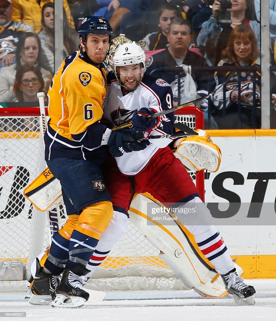 <a gi-track='captionPersonalityLinkClicked' href=/galleries/search?phrase=Shea+Weber&family=editorial&specificpeople=554412 ng-click='$event.stopPropagation()'>Shea Weber</a> #6 of the Nashville Predators battles in front of the crease against Colton Gillies #9 of the Columbus Blue Jackets during an NHL game at the Bridgestone Arena on March 23, 2013 in Nashville, Tennessee.