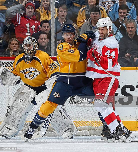 Shea Weber of the Nashville Predators battles Todd Bertuzzi of the Detroit Red Wings in front of Predators goalie Marek Mazanec at Bridgestone Arena...