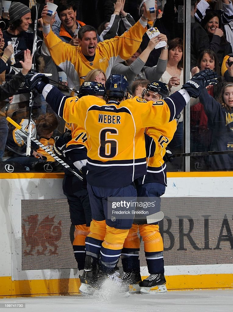 <a gi-track='captionPersonalityLinkClicked' href=/galleries/search?phrase=Shea+Weber&family=editorial&specificpeople=554412 ng-click='$event.stopPropagation()'>Shea Weber</a> #6 of the Nashville Predators celebrates the first goal of the season during action against the Columbus Blue Jackets at Bridgestone Arena on January 19, 2013 in Nashville, Tennessee.