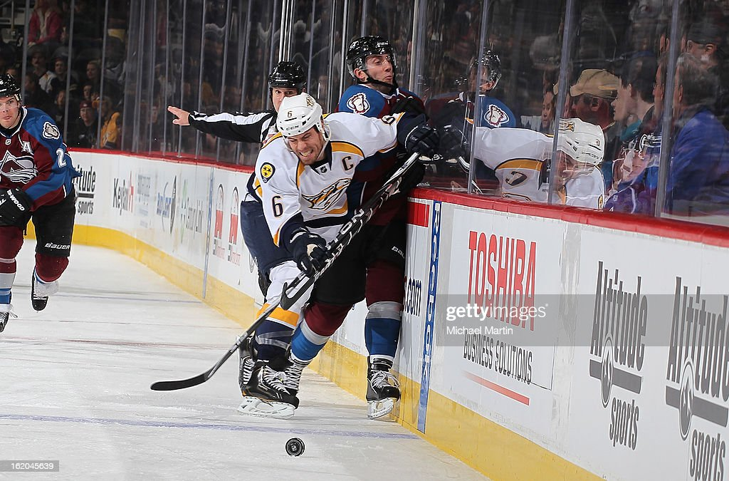 <a gi-track='captionPersonalityLinkClicked' href=/galleries/search?phrase=Shea+Weber&family=editorial&specificpeople=554412 ng-click='$event.stopPropagation()'>Shea Weber</a> #6 of the Nashville Predators checks Aaron Palushaj #17 of the Colorado Avalanche in the boards at the Pepsi Center on February 18, 2013 in Denver, Colorado.