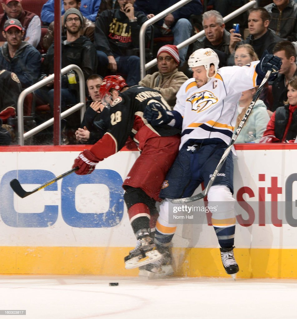Shea Weber #6 of the Nashville Predators checks Lauri Korpikoski #28 of the Phoenix Coyotes off the puck at Jobing.com Arena on January 28, 2013 in Glendale, Arizona.