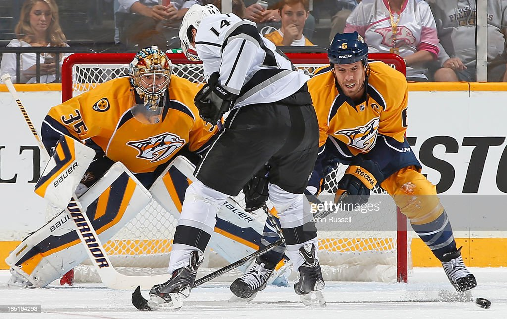 Shea Weber #6 of the Nashville Predators clears the puck from the stick of Justin Williams #14 of the Los Angeles Kings in front of goalie Pekka Rinne #35 at Bridgestone Arena on October 17, 2013 in Nashville, Tennessee.