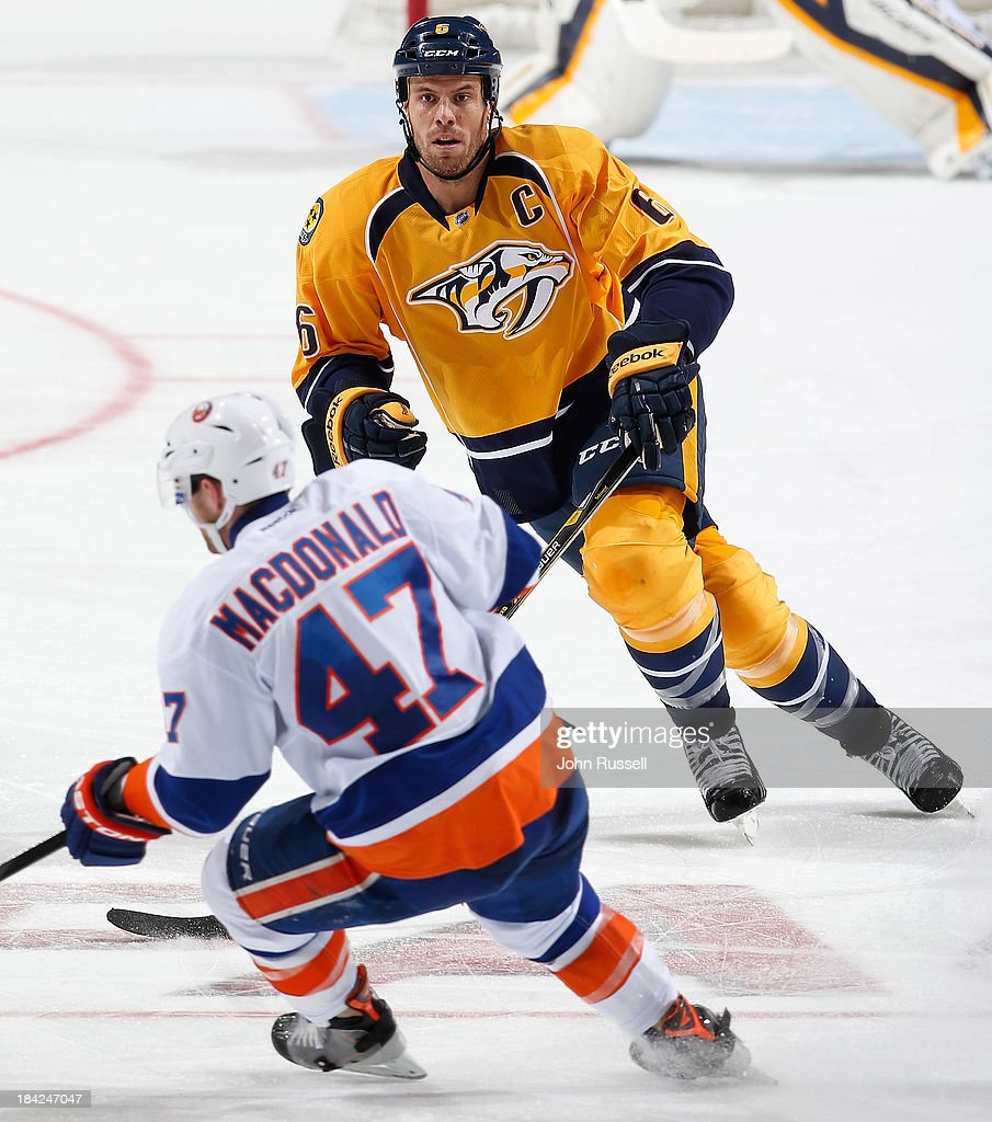 <a gi-track='captionPersonalityLinkClicked' href=/galleries/search?phrase=Shea+Weber&family=editorial&specificpeople=554412 ng-click='$event.stopPropagation()'>Shea Weber</a> #6 of the Nashville Predators defends against Andrew MacDonald #47 of the New York Islanders at Bridgestone Arena on October 12, 2013 in Nashville, Tennessee.