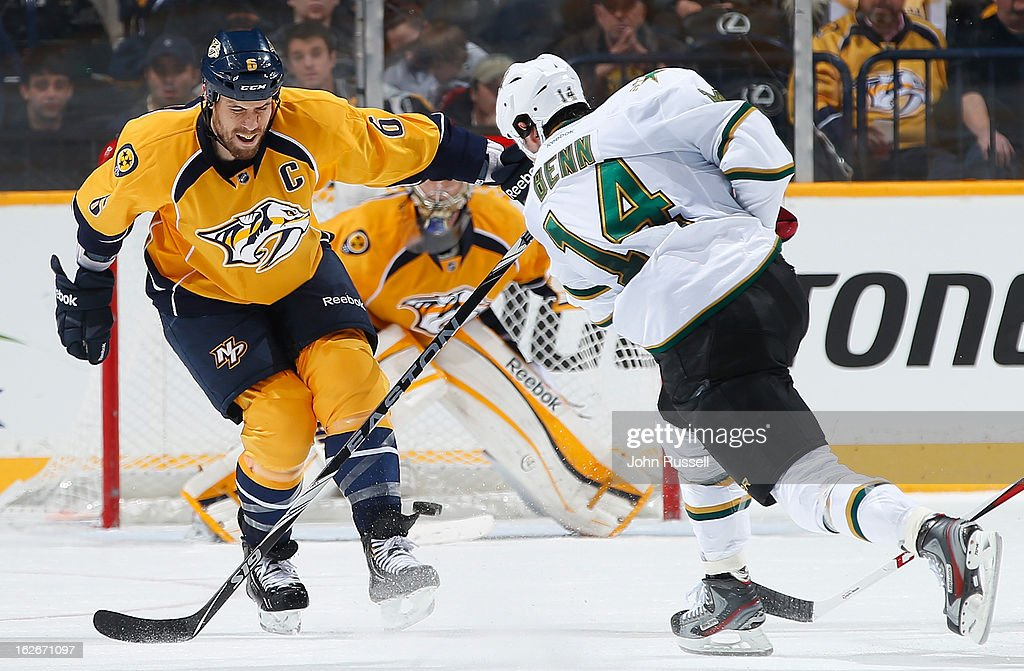 <a gi-track='captionPersonalityLinkClicked' href=/galleries/search?phrase=Shea+Weber&family=editorial&specificpeople=554412 ng-click='$event.stopPropagation()'>Shea Weber</a> #6 of the Nashville Predators deflects the shot of <a gi-track='captionPersonalityLinkClicked' href=/galleries/search?phrase=Jamie+Benn&family=editorial&specificpeople=4595070 ng-click='$event.stopPropagation()'>Jamie Benn</a> #14 of the Dallas Stars during an NHL game at the Bridgestone Arena on February 25, 2013 in Nashville, Tennessee.